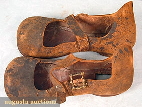 "GENTLEMAN'S SHOES, TUDOR STYLE Brown leather, wide rounded toes, brass side buckles, shoes from ""Lederman Collection"" purchased early 20th C & exhibited in Europe & USA, 4"" x 10.5"", unsure date these were made, (leather very worn & cracked,heels w/ cut out squares) fair."